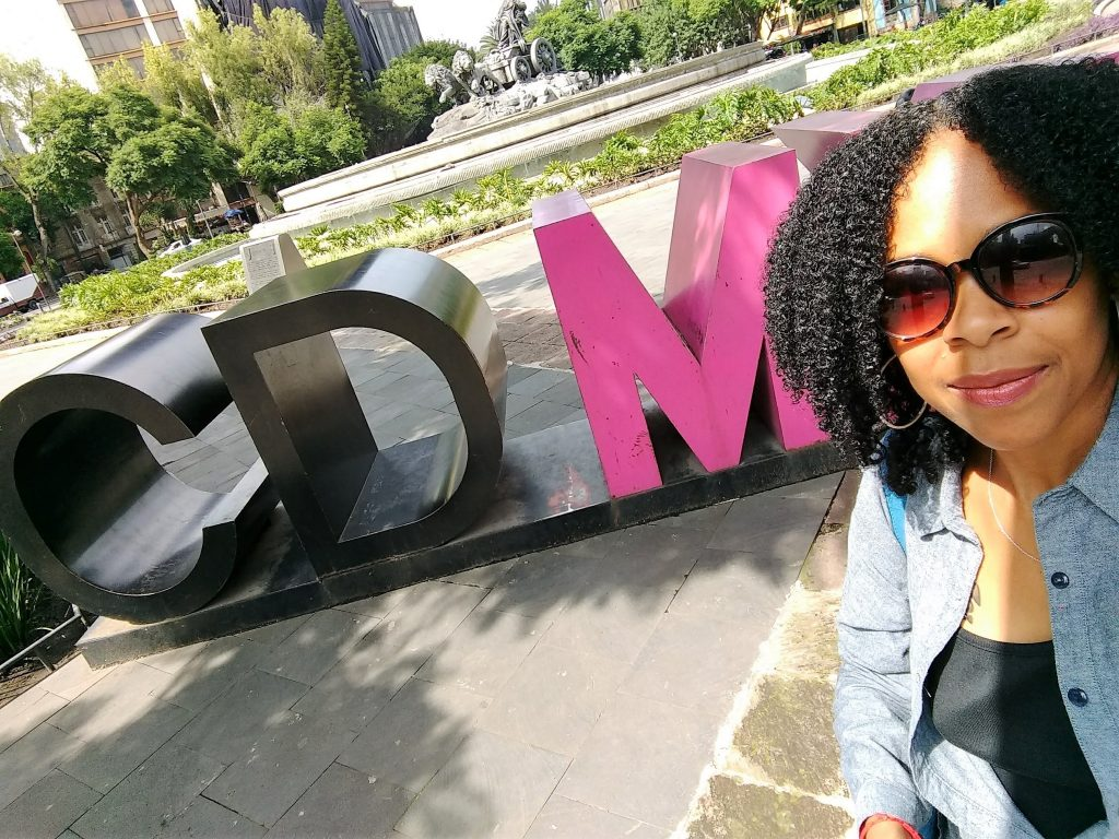 woman standing in front of CDMX sign