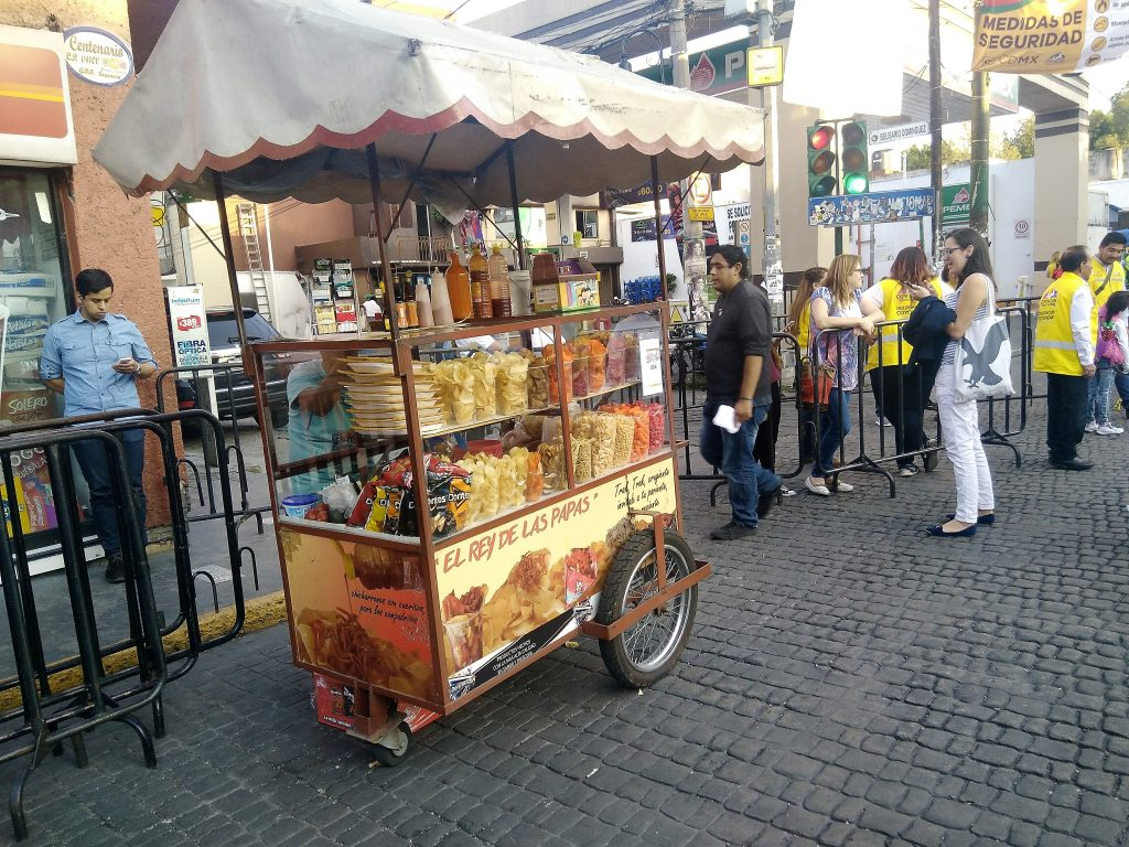 Street food cart selling freshly made potato chips