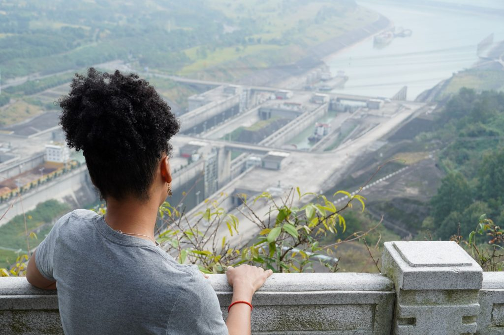 looking over woman's shoulder at the ship locks of the Three Gorges Dam