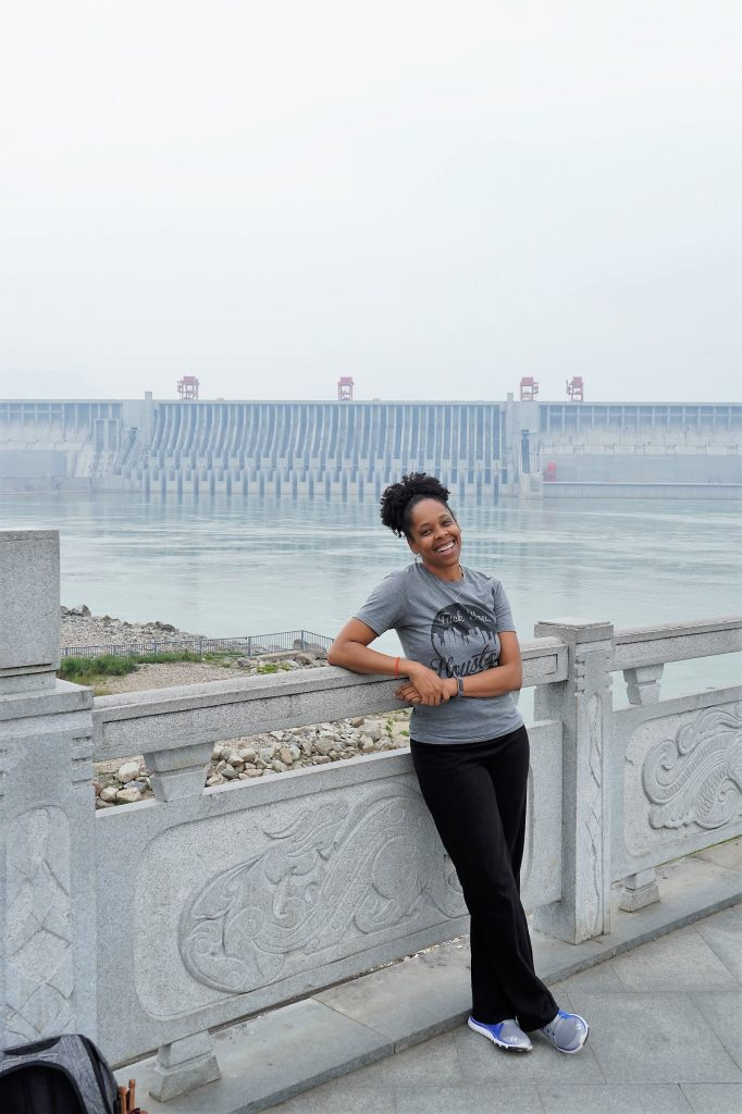 woman standing in front of Three Gorges Dam spillway